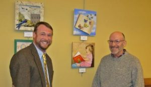 Library Director Justin Padgett and  easel Project Coordinator Richard Hutton